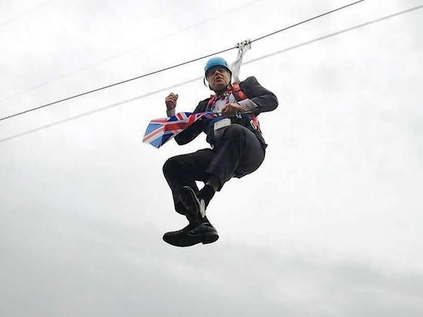 London Mayor Boris Johnson dangles from a zip line Aug. 1 in London's Victoria Park after a publicity stunt for the Olympic Games went awry.