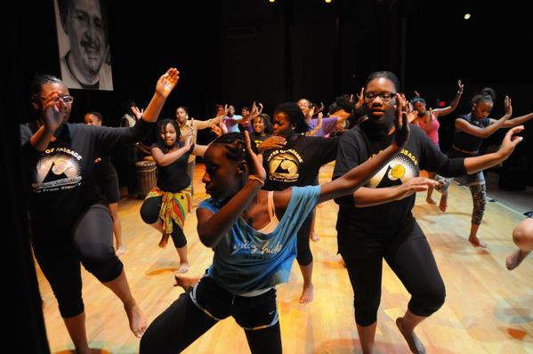 "Talia Clarke, 13, a member of The Artists Collective, rehearses a dance routine on stage at the Artists Collective Tuesday before Wednesday's presentation of  ""Color of Love,"" a play written and directed by Artist in Residence Michael Green. The play will be performed Wednesday Aug. 8 and Thursday Aug. 9 at 6:30 p.m. at the Artists Collective, 1200 Albany Ave. Tickets are $7. Call (860) 527-3205 for more information. The production, which includes music and dance, is the product of the Summer Youth Employment, Rites of Passage and Neighborhood Studios programs. The play portrays the struggle between a single mother and her daughter, who joins a gang."