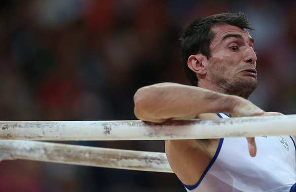 Greek gymnast Vasileios Tsolakidis  competes in the men's parallel bar final.