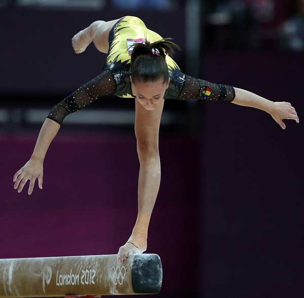 Larissa Andrea Iordache of Romania struggles to maintain her balance as she falls from the balance beam during the gymnastics final.