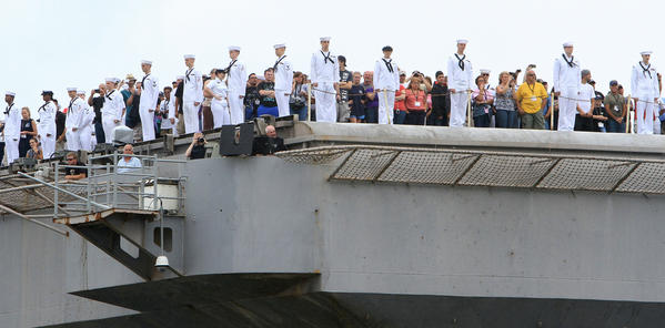 Sailors man the rails as the USS Abraham Lincoln arrives at Naval Station Norfolk on Tuesday.