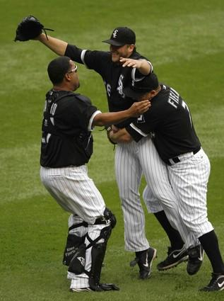 White Sox pitcher Mark Buehrle, who pitched only the second perfect game in the club's history today, celebrates with teammates on the field.