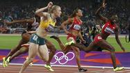 LONDON -- Dawn Harper probably smiled more Tuesday as an Olympic silver medalist than she did as a champion four years ago in Beijing, where the 100-meter hurdles title landed in her lap after teammate Lolo Jones stumbled.