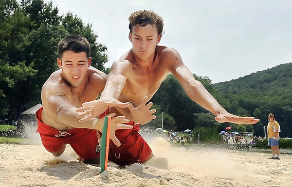 Assateague State Park lifeguard Mike DAmbrosio, left, and Gunpowder Falls State Park lifeguard Zach Crowther dive for a flag during the Maryland Park Service Lifeguard Competition Tuesday at Greenbrier State Park.
