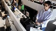 Sedentary office workers try standing desks