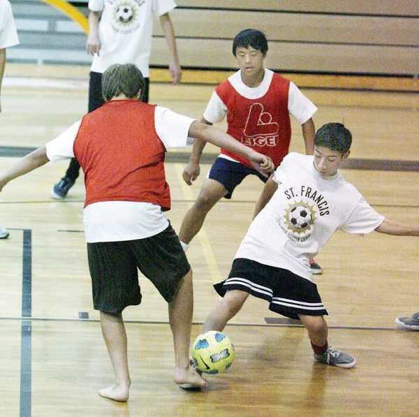 Players were divided baed on age and skill into different groups with groups competing in the gym at St. Francis High after the morning temperatures got too hot and humid at the St. Francis Soccer Camp.