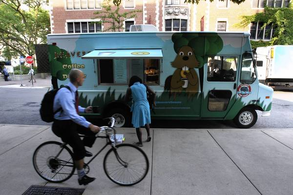 Beavers Coffee & Donuts parks July 3 at 58th Street and Ellis Avenue in Chicago's Hyde Park neighborhood. The food truck's owners are suing for the right to operate in Evanston.