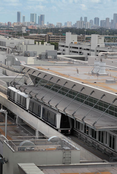 Miami International Airport's new skytrain is seen on September 16, 2010 in Miami, Florida. The train which is located in the new Concourse D uses four-car trains and carries passengers between stations on the roof of the mile-long concourse. With a capacity to transport 9,000 passengers per hour, the skytrain can get from one end of Concourse D to the other within five minutes.