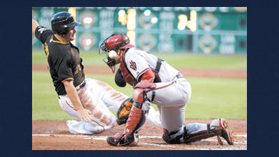 Pittsburgh Pirates' Travis Snider, left, slides past Arizona Diamondbacks catcher Miguel Montero as the ball skips away to score on a single by Andrew McCutchen in the third inning of a baseball game in Pittsburgh on Tuesday.