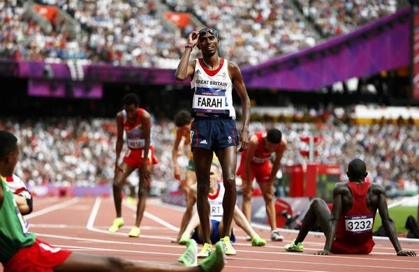 Britain's Mo Farah reacts after taking third place in his Men's 5000m round 1 heat at the London 2012 Olympic Games.