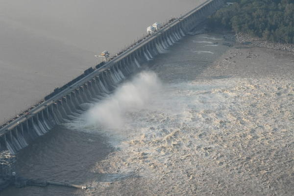 Muddy Susquehanna River surges through spill gates at Conowingo Dam after Tropical Storm Lee in September 2011