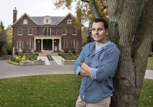 Reality TV star Bill Rancic stands in front of his renovated home in Hinsdale.