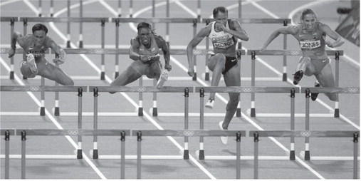 From left to right, the USA¿s Kellie Wells and Dawn Harper, Canada¿s Phylicia George, and the USA¿s Lolo Jones take the gates during the women¿s 100m hurdles at Olympic Stadium, during the 2012 Summer Olympic Games, in London on Tuesday. Harper took the silver medal and Wells claimed the bronze. MCT Photo