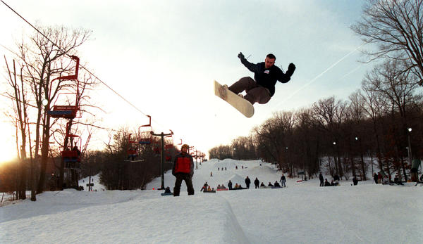 A snowboarder catches some air on the half-pipe in 2001.