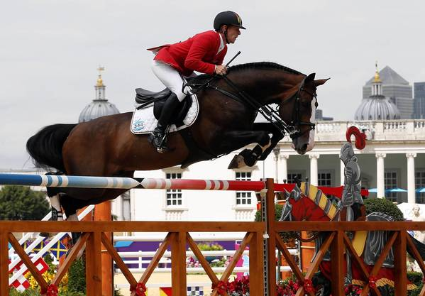 Germany's Marcus Ehning, on Plot Blue, competes during the Equestrian individual jumping event of the London 2012 Olympic Games.
