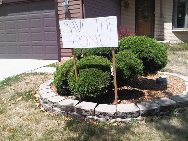 A homeowner in the Valley View Estates subdivision posted a sign reflecting the fear their pond will be ruined if it is naturalized.