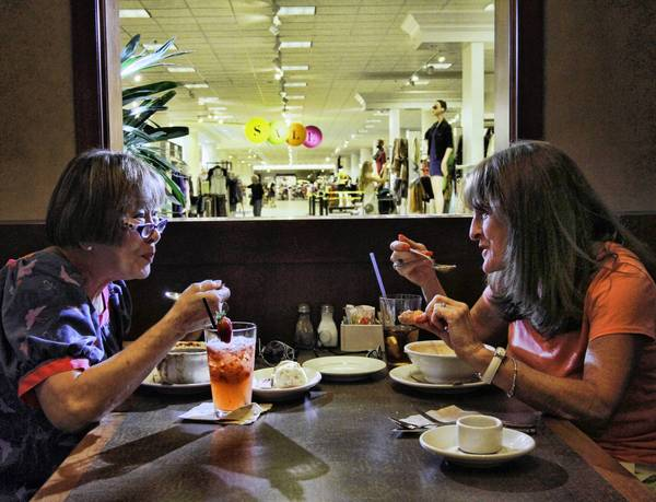 June Kohn, left, and Janet Howard enjoy lunch after shopping at Nordstrom's Bistro N in the Town Center at Boca Raton.