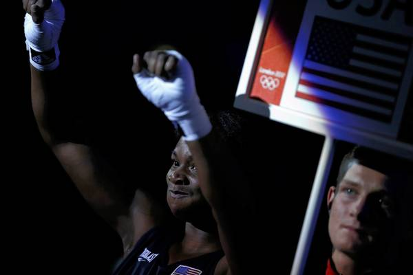 U.S. boxer Claressa Shields celebrates as she departs the ring after being declared the winner over Kazakhstan's Marina Volnova following their Women's Middle (75kg) semi-final boxing match at the London Olympic Games.