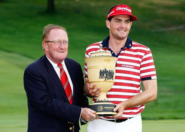Keegan Bradley (R) and Ryder Cup Director Richard Hills pose with Gary Player Cup following the final round of the World Golf Championships-Bridgestone Invitational at Firestone Country Club South Course.