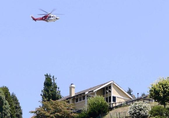A helicopter flies over a residential neighborhood in the L.A. region.