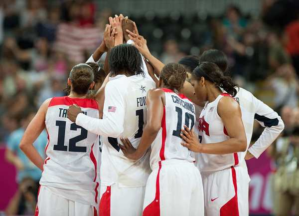 Team USA gathers at mid-court following their 81-56 win over Croatia at the Basketball Arena in the London Olympic Games.