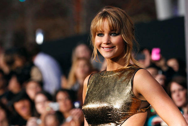 "Cast member Jennifer Lawrence poses at the premiere of ""The Hunger Games"" at Nokia theatre in Los Angeles, California March 12, 2012."