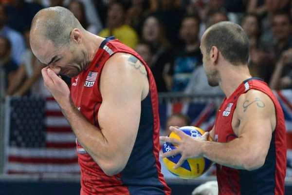 Clay Stanley, left, of the U.S. reacts during the men's quarterfinal volleyball match with Italy.