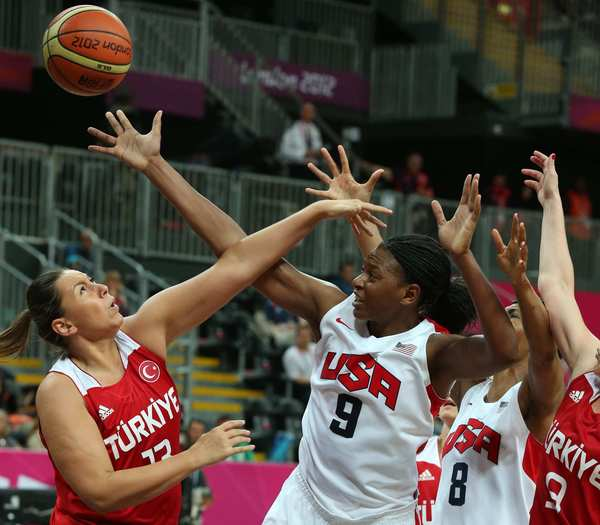 Turkey's Yasemin Horasan battles Team USA forward Asjha Jones for a rebound in the second half of a preliminary game. The U.S. won 89-58.