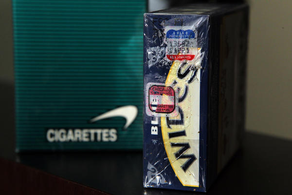 A pack of cigarettes showing one stamp for the state of Illinois and one combined for both the city and county to collect their taxes. Photo from February 2012.