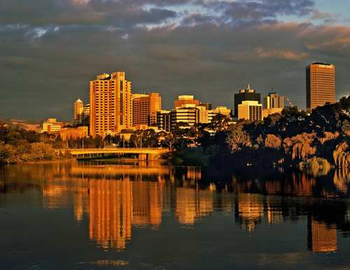 Adelaide, in South Australia, is reflected in Lake Torrens at dusk.