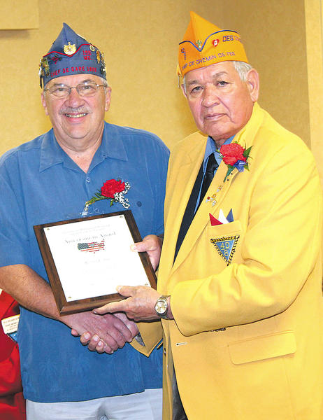 Richard L. Stup, left, of Frederick, Md., is presented the Grande Voiture de Maryland Americanism Award by National Chef de Chemin de Fer Robert Molina of the Society of the Forty and Eight.