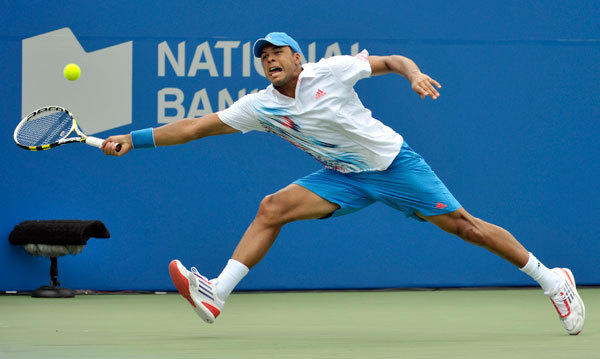 Jo-Wilfried Tsonga of France returns a shot to Jeremy Chardy of France during their match at the Toronto Masters tennis tournament in Toronto August 8, 2012.