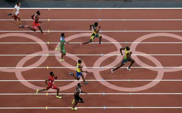 Jamaica's Usain Bolt, right, leads his 200-meter semifinal heat Wednesday.