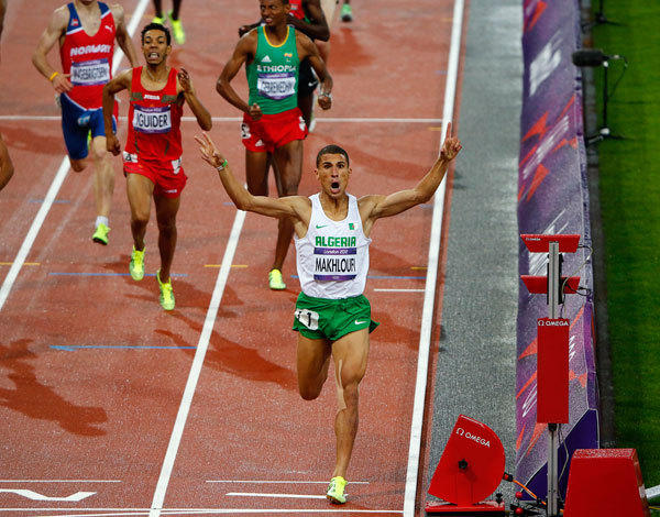 Algeria's Taoufik Makhloufi celebrates as he wins the men's 1500m final during the London 2012 Olympic Games at the Olympic Stadium August 7, 2012.