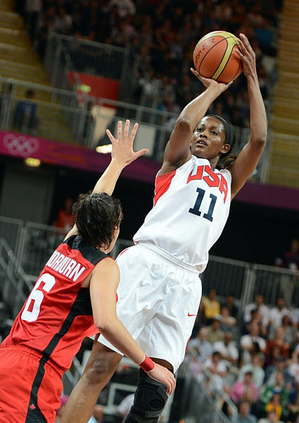 Former UConn star Swin Cash competes in women's basketball.
