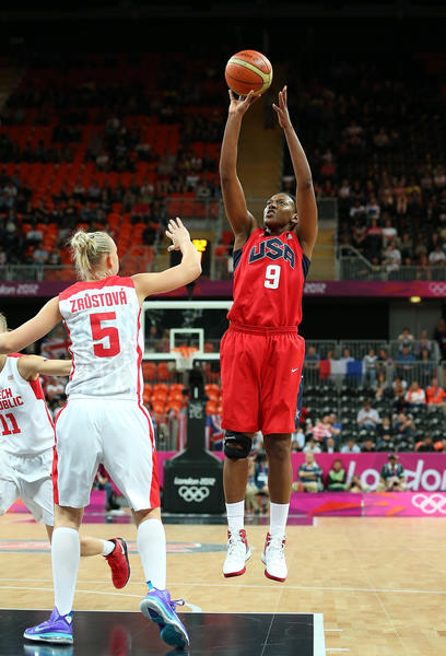 Former UConn star Asjha Jones competes in basketball.