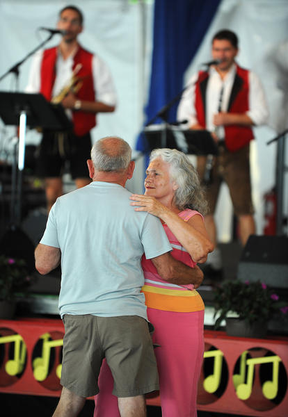 Marge Binder of Northampton and Dan Keen of Freemansburg dance to the music of German band Westallgaier at the Festplatz at Musikfest Wednesday.