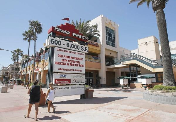 The owner of the Pierside Pavilion in Huntington Beach is looking to expand by adding a restaurant, retail and office space. Some neighbors, however, are voicing opposition to the expansion.