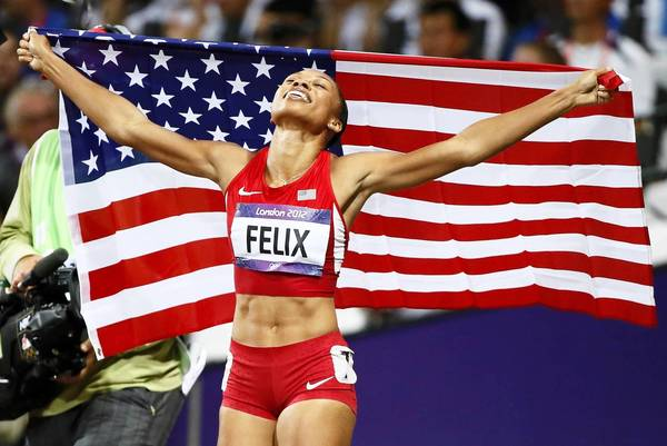 U.S. runner Allyson Felix celebrates after winning gold in the Women's 200m final during the London 2012 Olympic Games at the Olympic Stadium.
