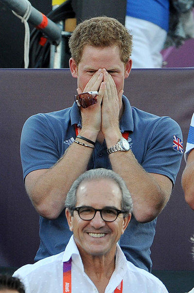 Prince Harry watches Beach Volleyball on Day 12 of the London 2012 Olympic Games at Horse Guards Parade on August 8, 2012 in London, England.