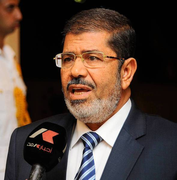 Egyptian President Mohamed Morsi met with Iran's vice president, a visit that gave Iran a diplomatic coup amid sharpening international pressure over its nuclear program and links to Syria.