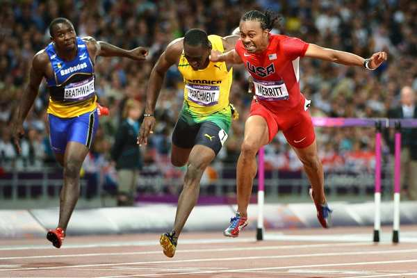 Team USA's Aries Merritt, right, crosses the finish line in front of Barbados' Ryan Brathwaite, left, and Jamaica's Hansle Parchment to win the gold medal in the 110-meter hurdles at the 2012 London Olympics. Jason Richardson of the U.S. won silver.