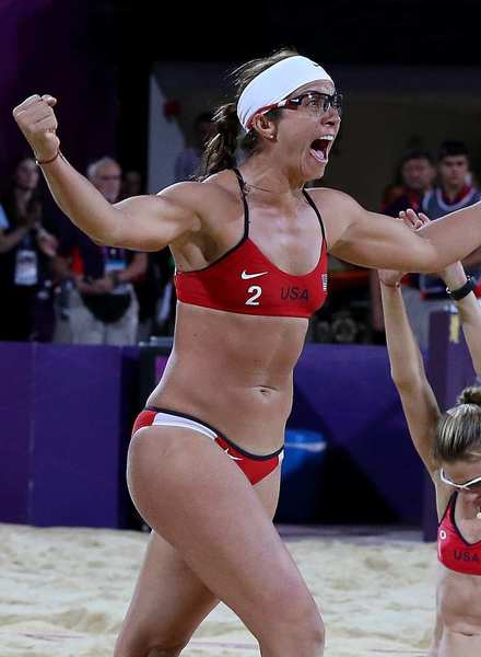 Misty May-Treanor, left, and Kerri Walsh Jennings celebrate another gold medal in women's beach volleyball.