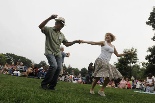 Joel Silvestro, of Kensington, left, and Prudence Sloane, of Avon, dance to the music of Beatles Forever at Elizabeth Park during the park's free summer concert series held every Wednesday through Aug. 29 from 6:30 to 8 p.m. Both are members of the performance dance troupe Stardust Dancers.