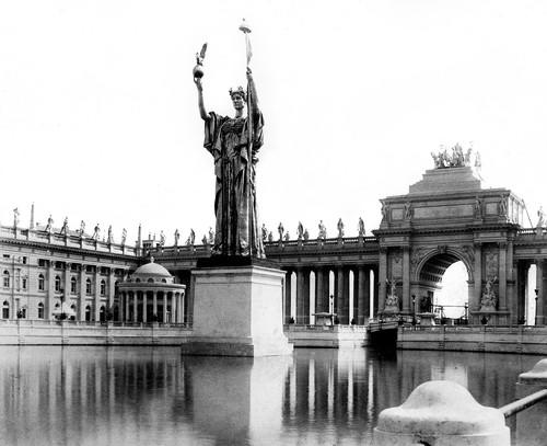 At the center of the exposition's Court of Honor was the Statue of the Republic, designed by Daniel Chester French. The expo was held in Jackson Park and the Midway Plaisance. A replica of the statue now stands in Jackson Park.