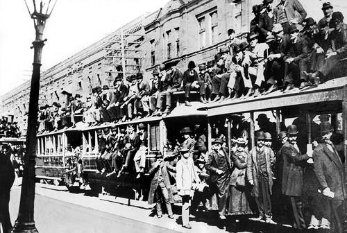 Exposition crowds were so huge at times that trains, like this one on Cottage Grove Avenue, carried an overflow of passengers on the roofs of the cars.