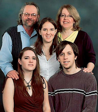 Four members of the Engelhardt family were stabbed on Friday, April 17, 2009. The Engelhardt family is, (clockwise from top left) Alan, Shelly, Jeff, Amanda and Laura (in the middle). Alan, 57,  Laura, 18, and Laura's grandmother, Marlene Gacek, 73, (not in this photo) died as a result of their injuries. Engelhardt's mother, Shelly, is in critical condition. The victims were stabbed in the family home in Hoffman Estates, authorities said. D'Andre Howard, 20, a man who had a relationship with Amanda, has been charged with their slayings.
