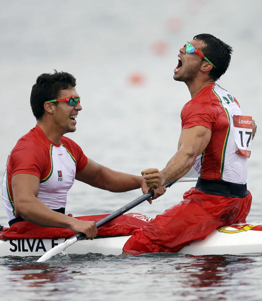 Emanuel Silva, left, and Fernando Pimenta of Portugal celebrate winning silver during the men's kayak double 1000-meter canoe sprint.