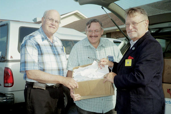 Smithsburg Lions Club President Frank Schaller, right, and Immediate Past President Jeff Weaver, left, present recycled eyeglasses to Bob Martin of the Myersville (Md.) Lions Club.