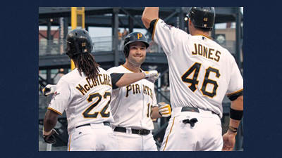 Pittsburgh Pirates' Neil Walker (18) is greeted by Garrett Jones (46) and Andrew McCutchen (22) after driving them in with a three-run home run in the first inning of a baseball game against the Arizona Diamondbacks on Wednesday in Pittsburgh.